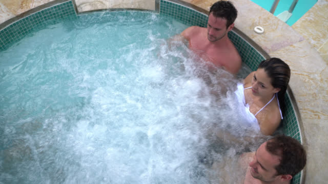 Group of people at a spa retreat having fun at the jacuzzi