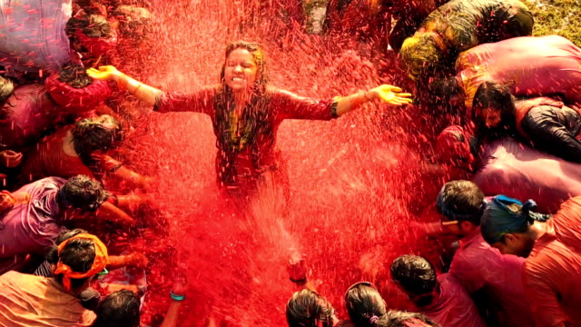 group of people celebrating holi festival, delhi, india - india video stock e b–roll