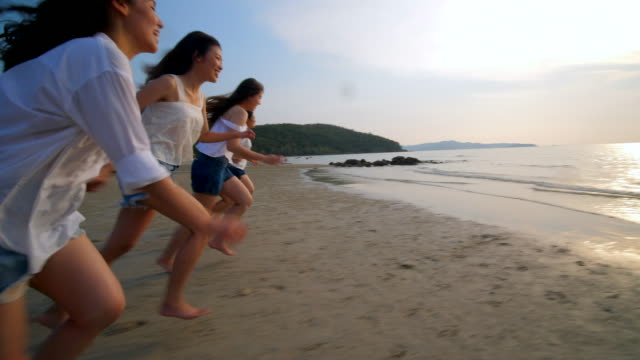 group of people cheer up on the beach - thailand stock videos & royalty-free footage
