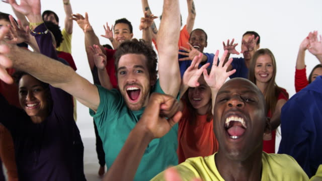 Group of People Cheering and Smiling with Enthusiasm