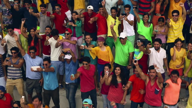 group of people clicking picture with mobile phones at stadium, delhi, india - telecommunications equipment stock videos & royalty-free footage