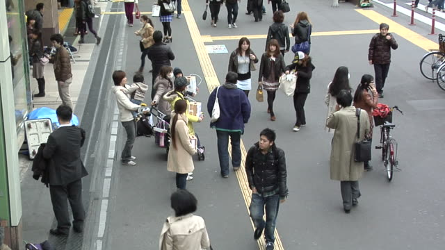 group of people collect money in front of shinjuku south station for the earthquake victims - donation box stock videos & royalty-free footage