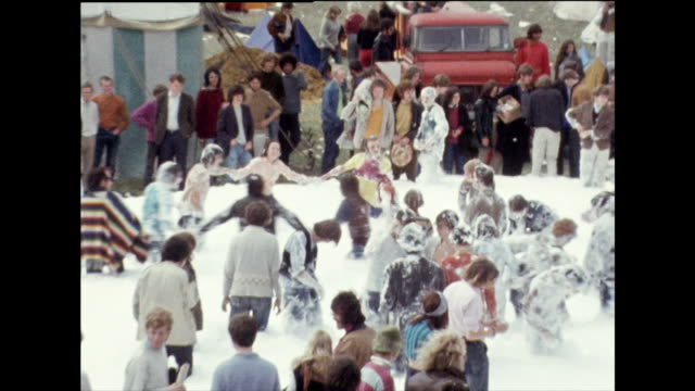 group of people dance around in foam; 1969 - hippy stock videos & royalty-free footage