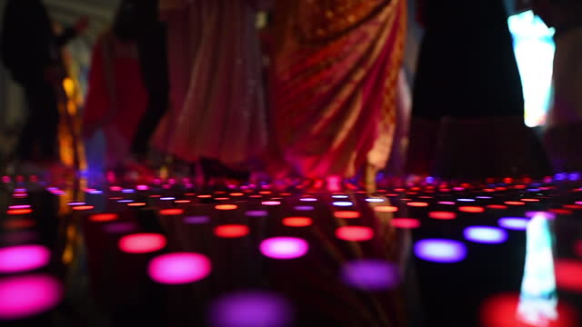 group of people dancing at illuminated led dancing floor inside hall - dance floor stock videos & royalty-free footage