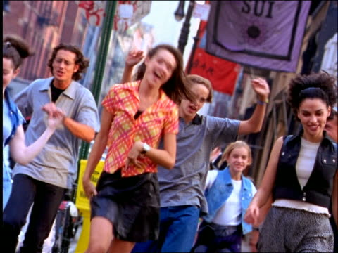 group of people dancing + crossing street in soho / nyc - 1997 stock-videos und b-roll-filmmaterial