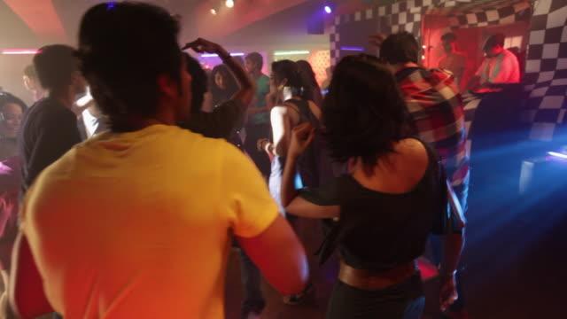 Group of people dancing in a nightclub