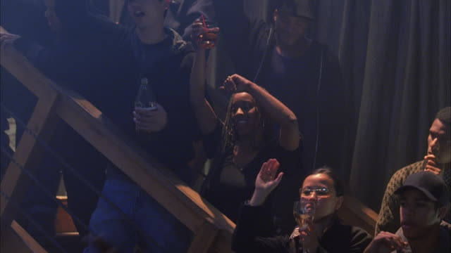 ms pan group of people dancing in nightclub - hip hop stock videos and b-roll footage