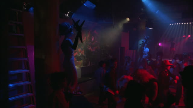 ws pan group of people dancing in nightclub - hip hop stock videos and b-roll footage