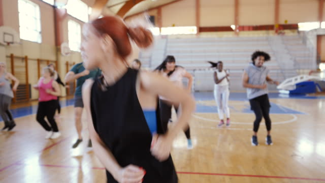 group of people dancing on zumba class - dance studio stock videos & royalty-free footage
