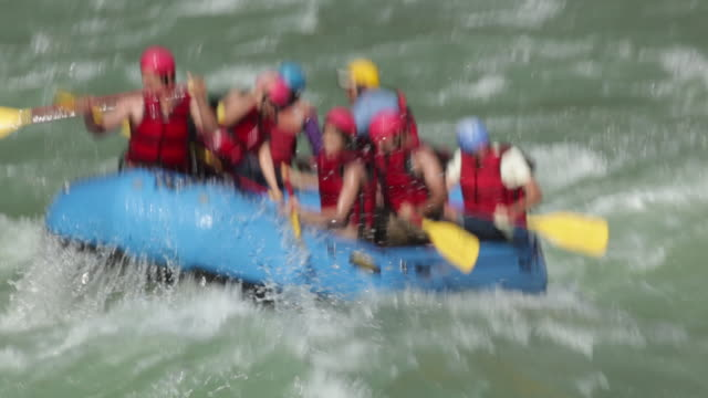 Group of people doing river rafting