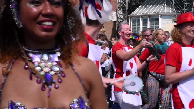 A group of people dressed up as playing cards are walking past the camera in the Brighton Gay Pride Parade 2017