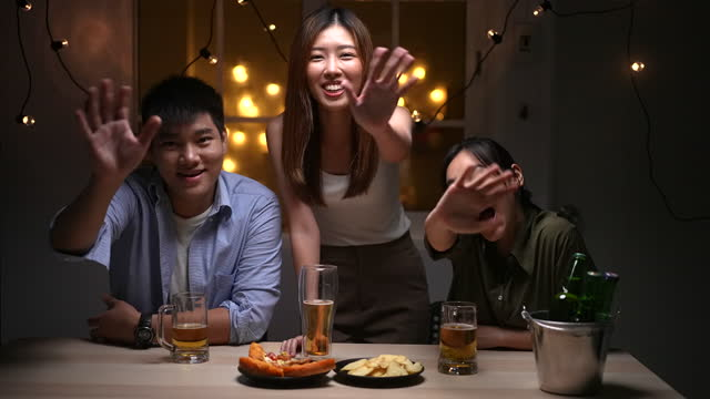 group of people drinking beer having virtual party with friend on laptop at home, social distancing - chinese ethnicity stock videos & royalty-free footage