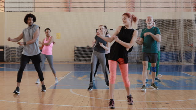 group of people enjoying a zumba class - active lifestyle stock videos & royalty-free footage
