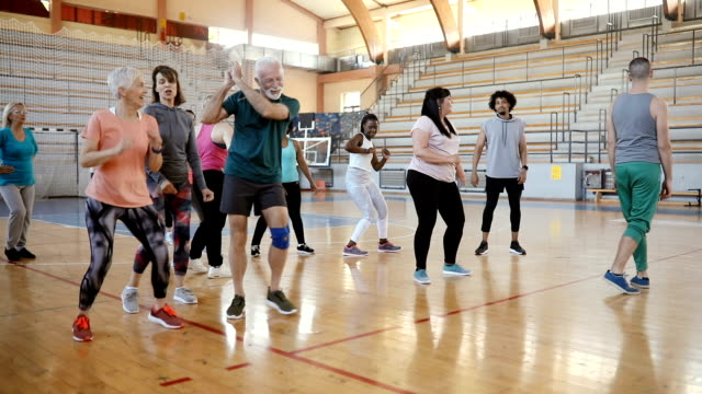 group of people enjoying a zumba class - aerobics stock videos & royalty-free footage