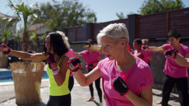 group of people enjoying boxing exercises - fitness instructor stock videos & royalty-free footage