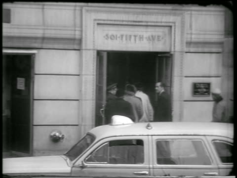 b/w 1951 group of people entering building on fifth avenue in civil defense drill / nyc / newsreel - 1951 stock videos & royalty-free footage