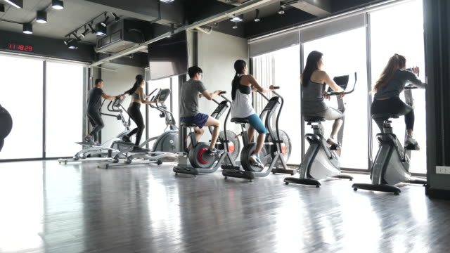 group of people exercising in gym - cross trainer stock videos & royalty-free footage