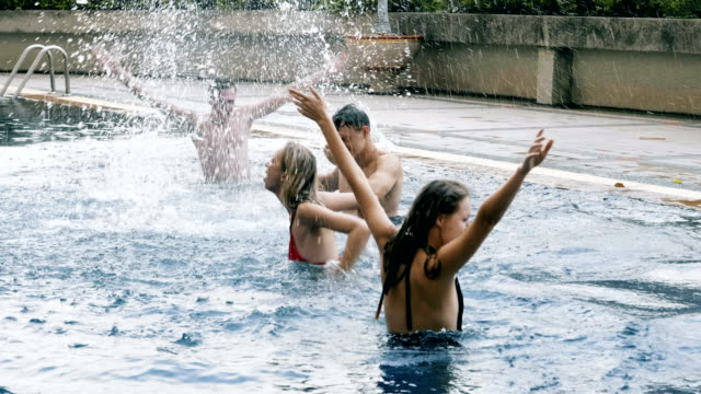 group of people funny jump into the pool - hand raised stock videos & royalty-free footage
