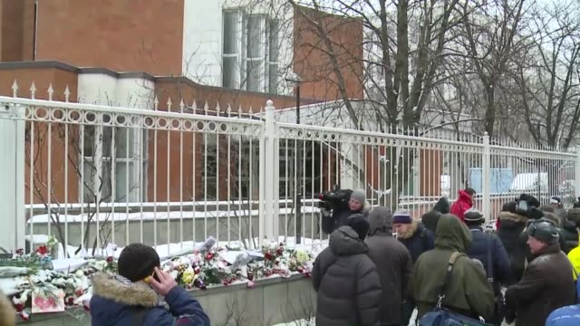 a group of people gather in front of french embassy in moscow and put flowers to commemorate the victims of the attack on french satirical magazine... - materiale cartaceo video stock e b–roll