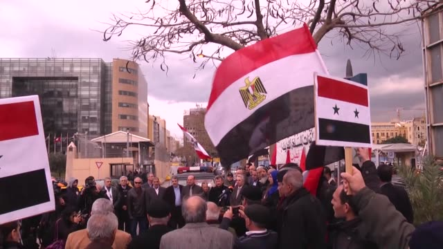 group of people gather in front of the united nations office in beirut to hold a demonstration against the mass beheading of 21 egyptian coptic... - isis beheading stock-videos und b-roll-filmmaterial