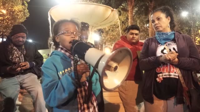 A group of people gather to protest the grand jury's decision about the police Officer Darren Wilson shot the black teenager Michael Brown dead on...