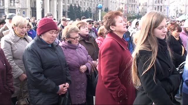 group of people gathered at the independence square pray for the establishment of peace and stability in the country in kiev, capital city of... - stability stock videos & royalty-free footage