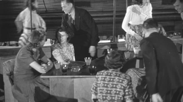 1948 Group of people having dinner on a cruise and then getting up to waltz on the dance floor /