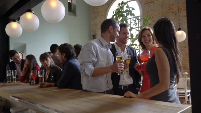 group of people having drinks after work - happy hour video stock e b–roll