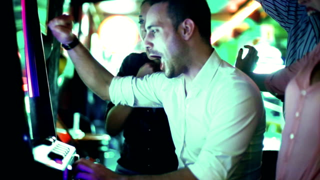 stockvideo's en b-roll-footage met group of people having fun in casino. - casino