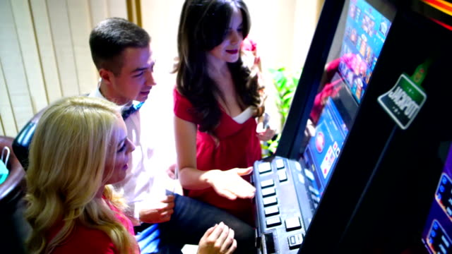 group of people having fun in casino. - money makes the world go around stock videos and b-roll footage