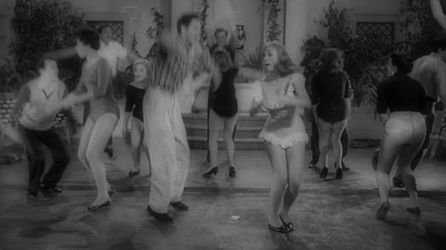 group of people having fun swing dancing to a jazz band at a party. - 1950 stock-videos und b-roll-filmmaterial