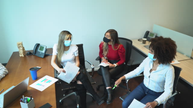 group of people in an office in a meeting - colombian ethnicity stock videos & royalty-free footage