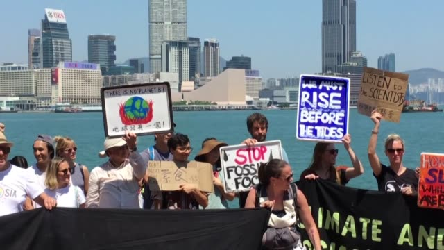 a group of people in hong kong protests as part of the fridays for future movement to demand faster action to tackle climate change - climate protest stock videos & royalty-free footage