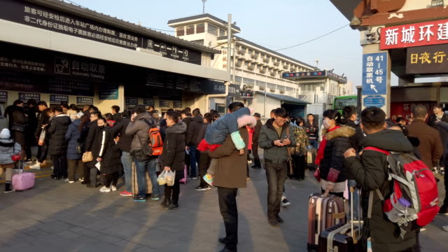 group of people in train station,xi'an,china. - railway station stock videos & royalty-free footage