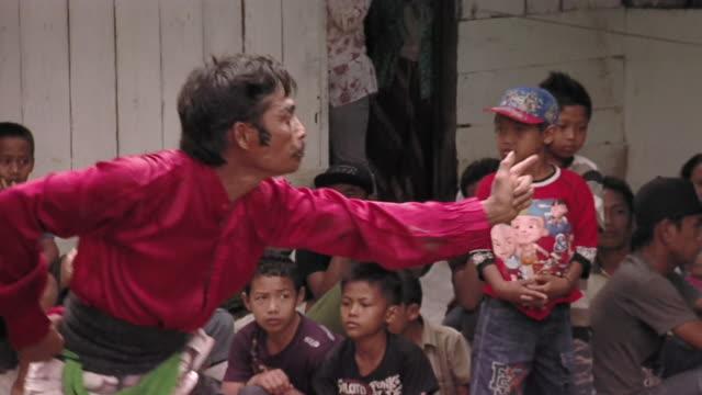 ms pan group of people in trance dance  / surabaya, east java, indonesia  - nur männer über 30 stock-videos und b-roll-filmmaterial