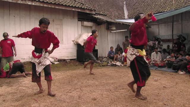 ms group of people in trance dance  / surabaya, east java, indonesia  - nur männer über 30 stock-videos und b-roll-filmmaterial