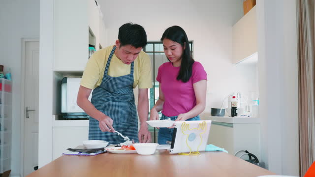 group of people learn to making sushi in their own house - japanese food stock videos & royalty-free footage
