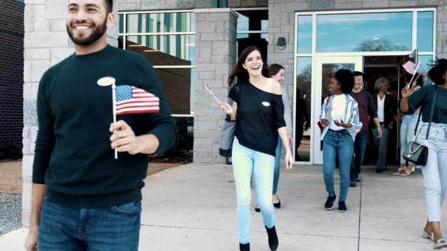 group of people leave polling place on election day - partito repubblicano degli usa video stock e b–roll