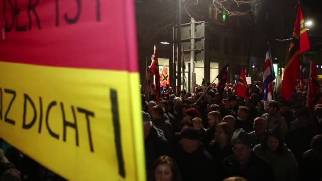 """group of people, led by far right movement pegida gather on a demonstration against """"islam"""" and immigrants at neumarkt square in dresden, germany on... - dresden germany stock videos & royalty-free footage"""