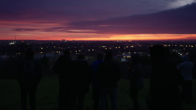 group of people moon sighting at sunset in croydon, london - optical equipment stock videos & royalty-free footage