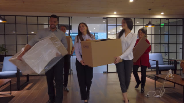 group of people moving office - moving office stock videos & royalty-free footage