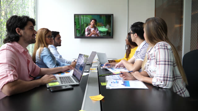 group of people on a video conference all paying attention to a black colleague talking very enthusiastic and happy - efficiency stock videos and b-roll footage
