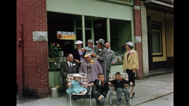 stockvideo's en b-roll-footage met 1955 montage group of people outside store, girls (5-6) in blue dresses, in backyard / toronto, canada - 1955