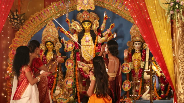 MS Group of people performing Durga puja during Durga Puja festival / New Delhi, Delhi, India