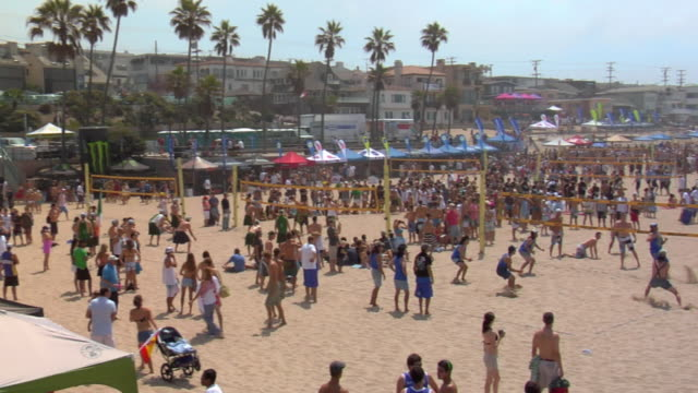 ws pan group of people playing beach volleyball / manhattan beach, california, usa - stereo stock videos and b-roll footage