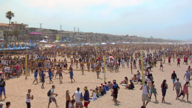 ws group of people playing beach volleyball / manhattan beach, california, usa - stereo stock videos and b-roll footage