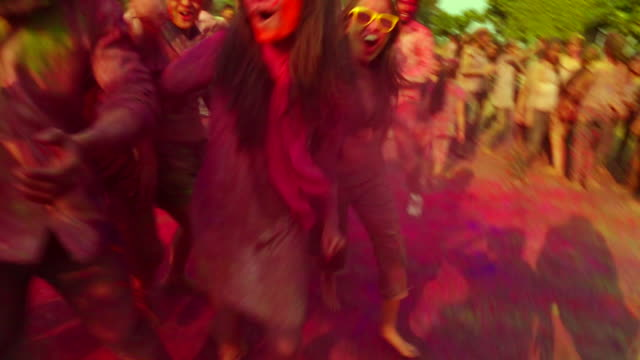 group of people playing holi and dancing, delhi, india - teenage girls video stock e b–roll