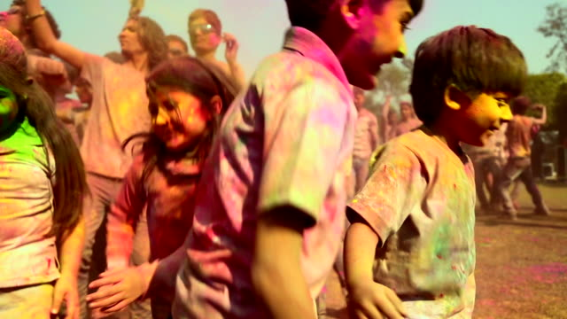 group of people playing holi and dancing, delhi, india - traditional festival stock videos & royalty-free footage
