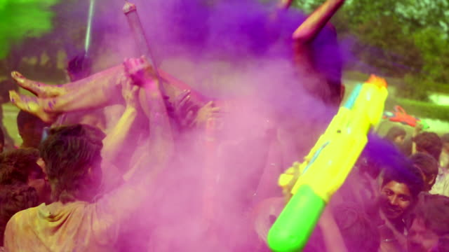 group of people playing holi, delhi, india - squirt gun stock videos and b-roll footage