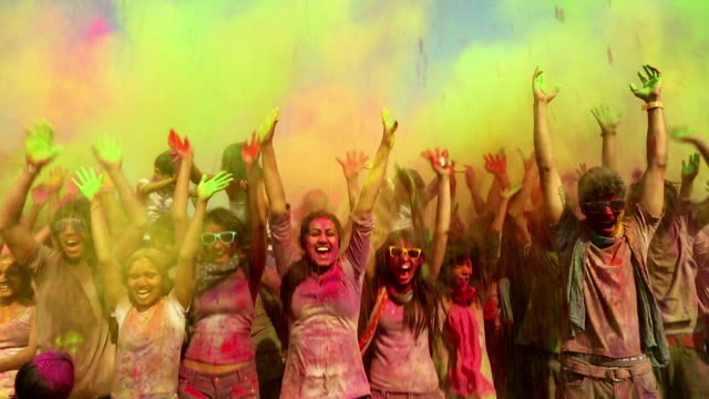 Group of people playing holi, Delhi, India